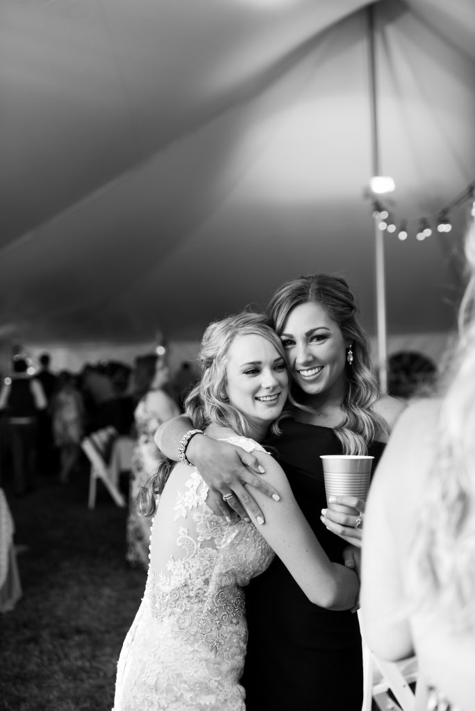Bride and best friend at wedding reception