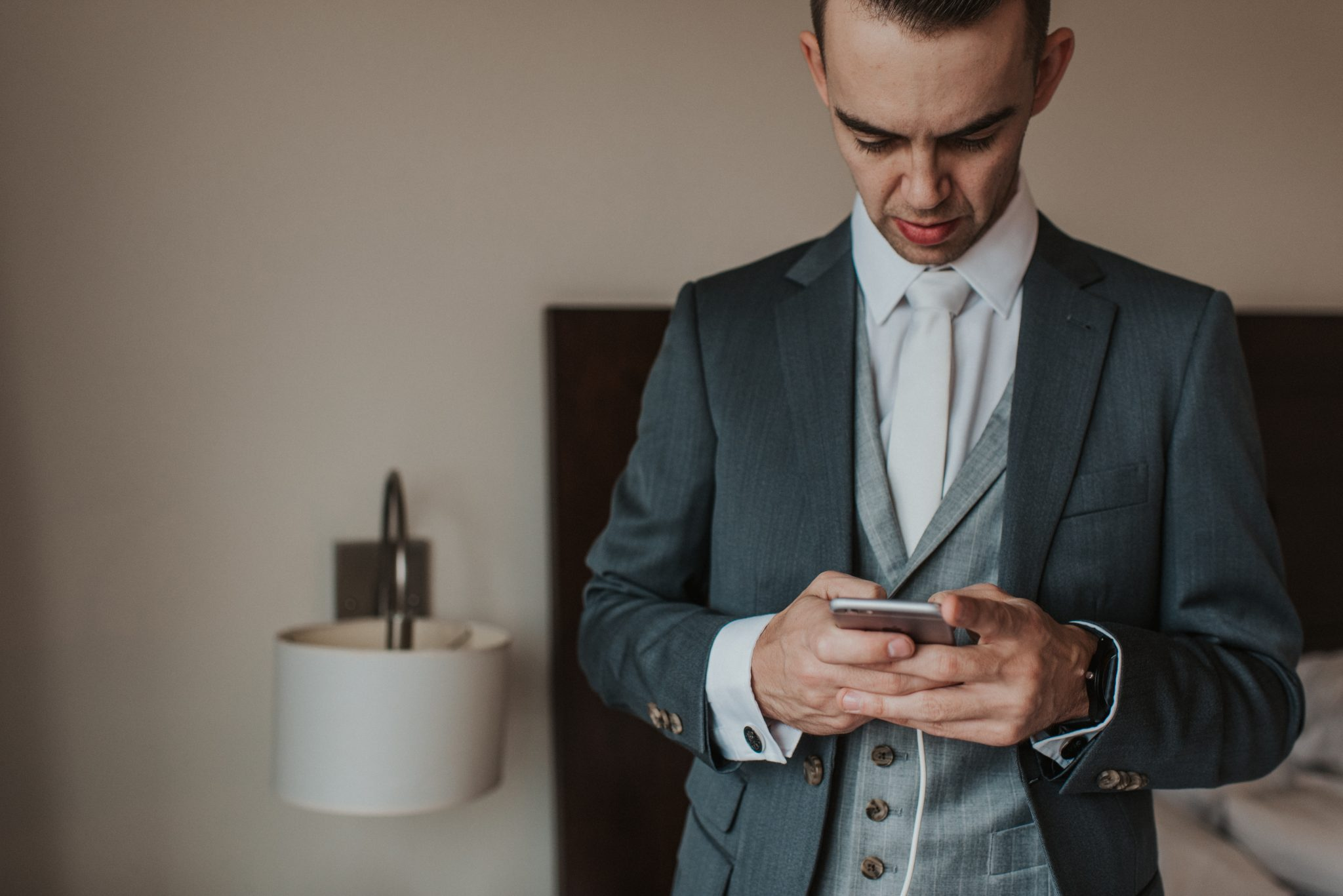 Groom Checking Phone