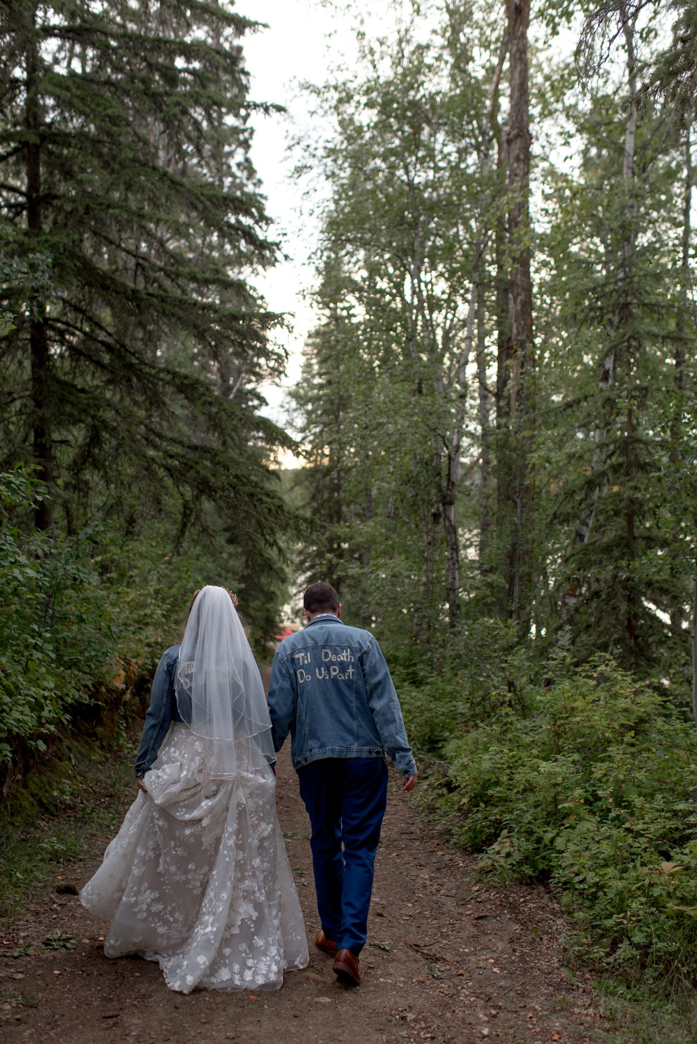 Matching wedding day jean jackets for bride and groom