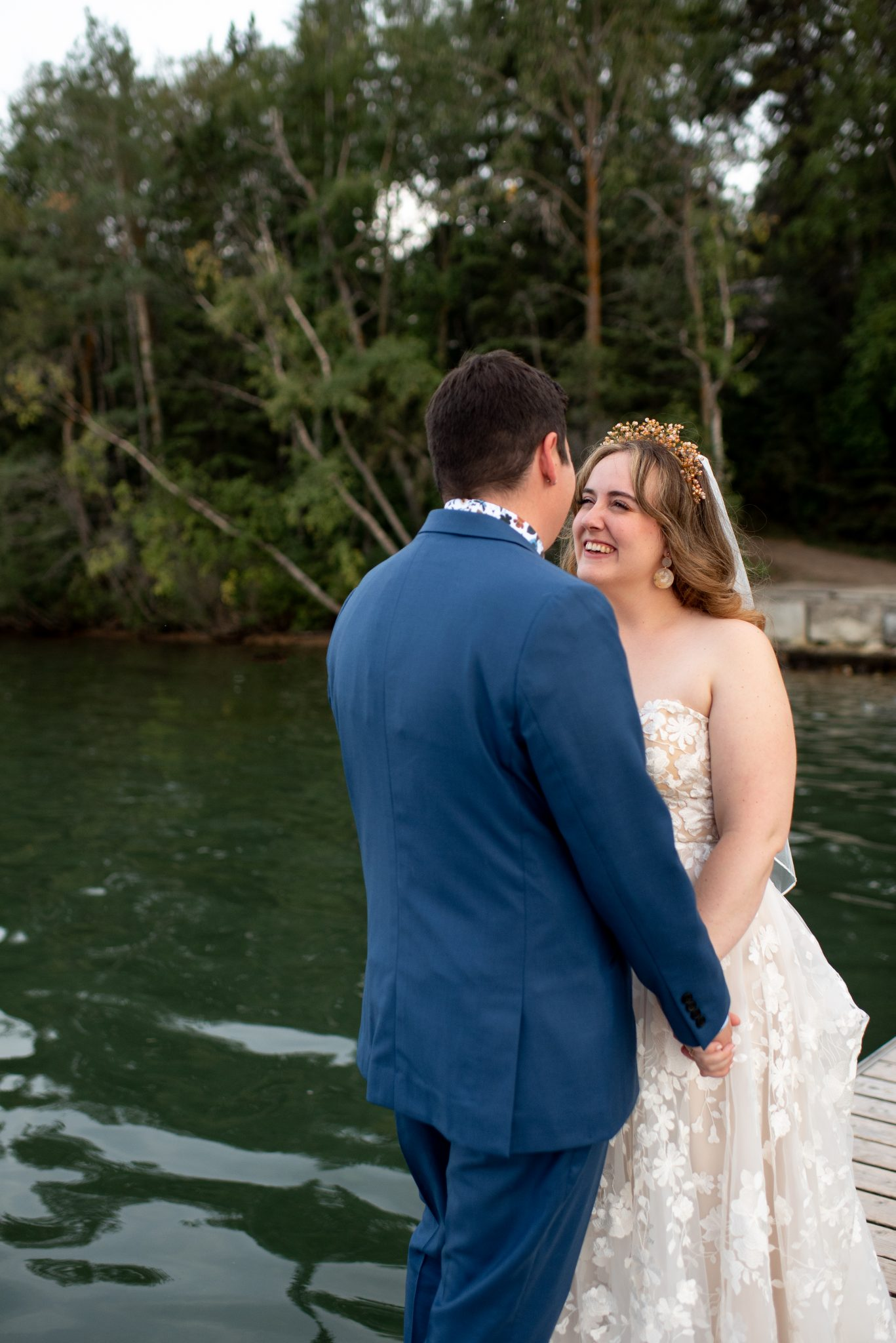 Lakeside wedding portraits for Alberta bride and groom at this Sylvan Lake wedding