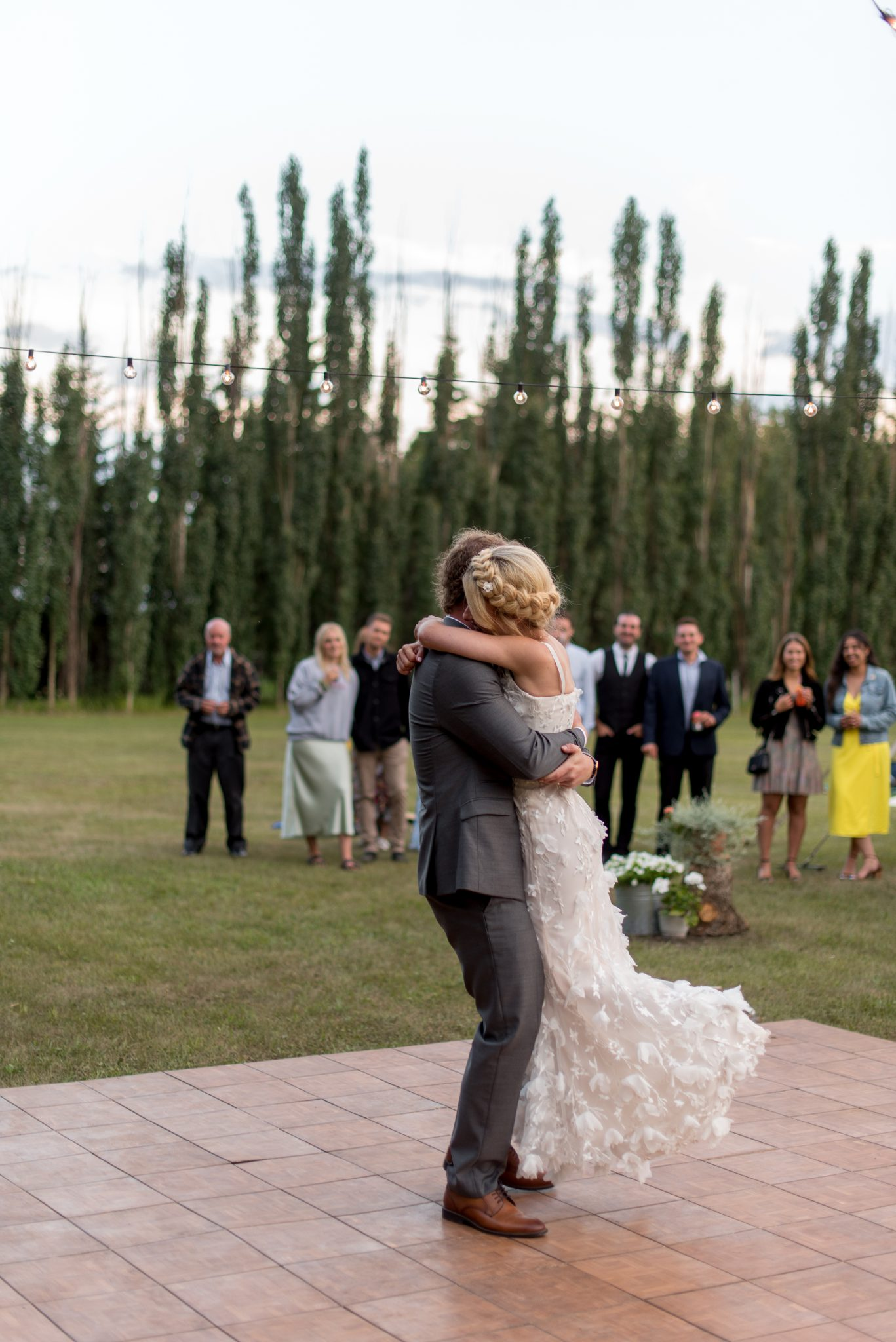 Outdoor wedding first dance on a summer day