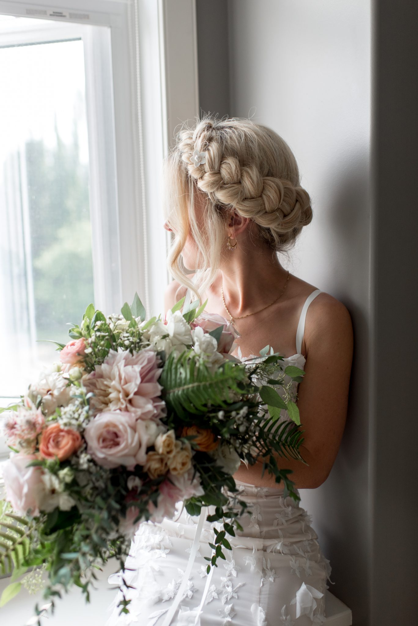 Romantic updo with braids for bridal hair inspiration