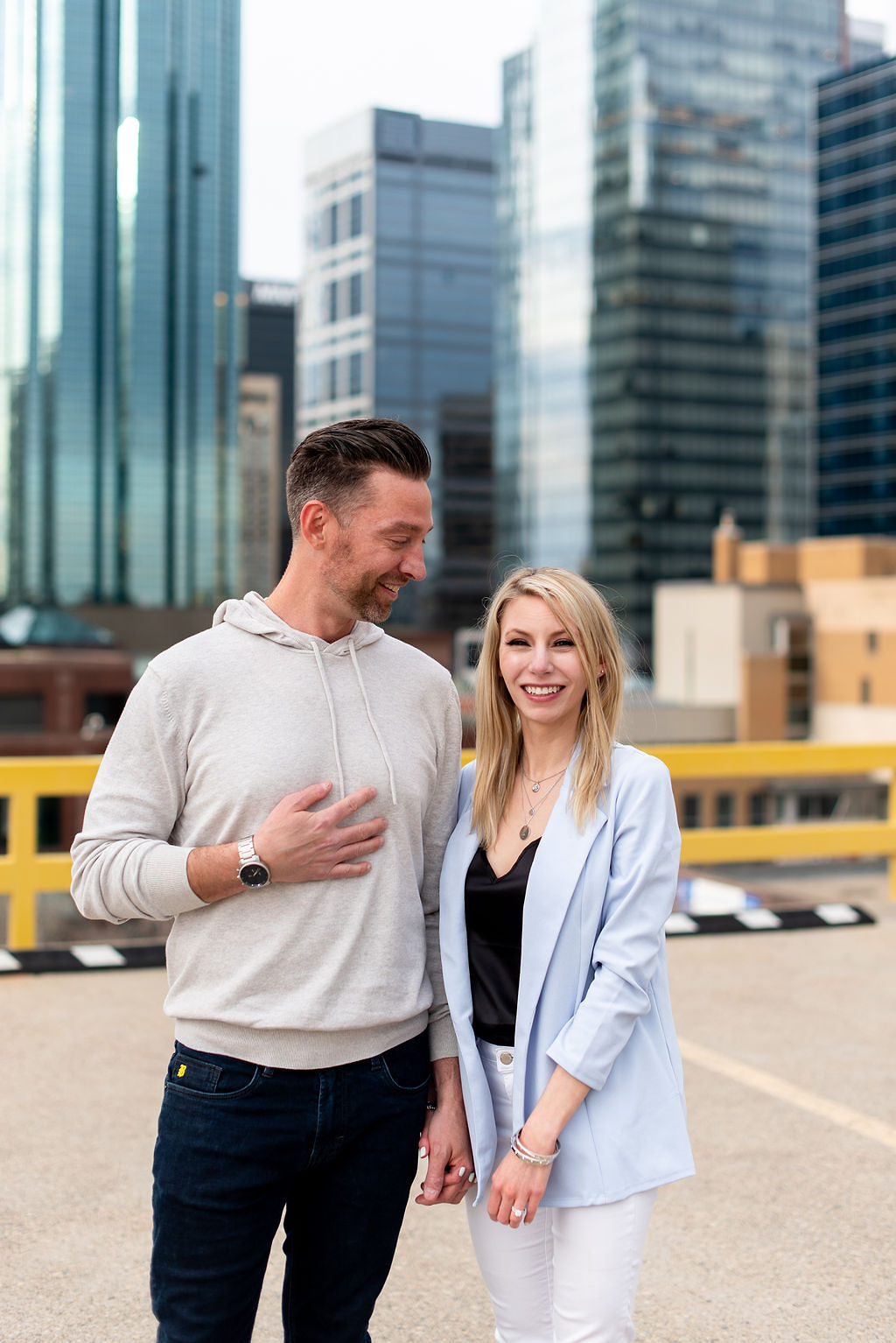 Edmonton Alberta rooftop proposal with the Edmonton downtown skyline in the background