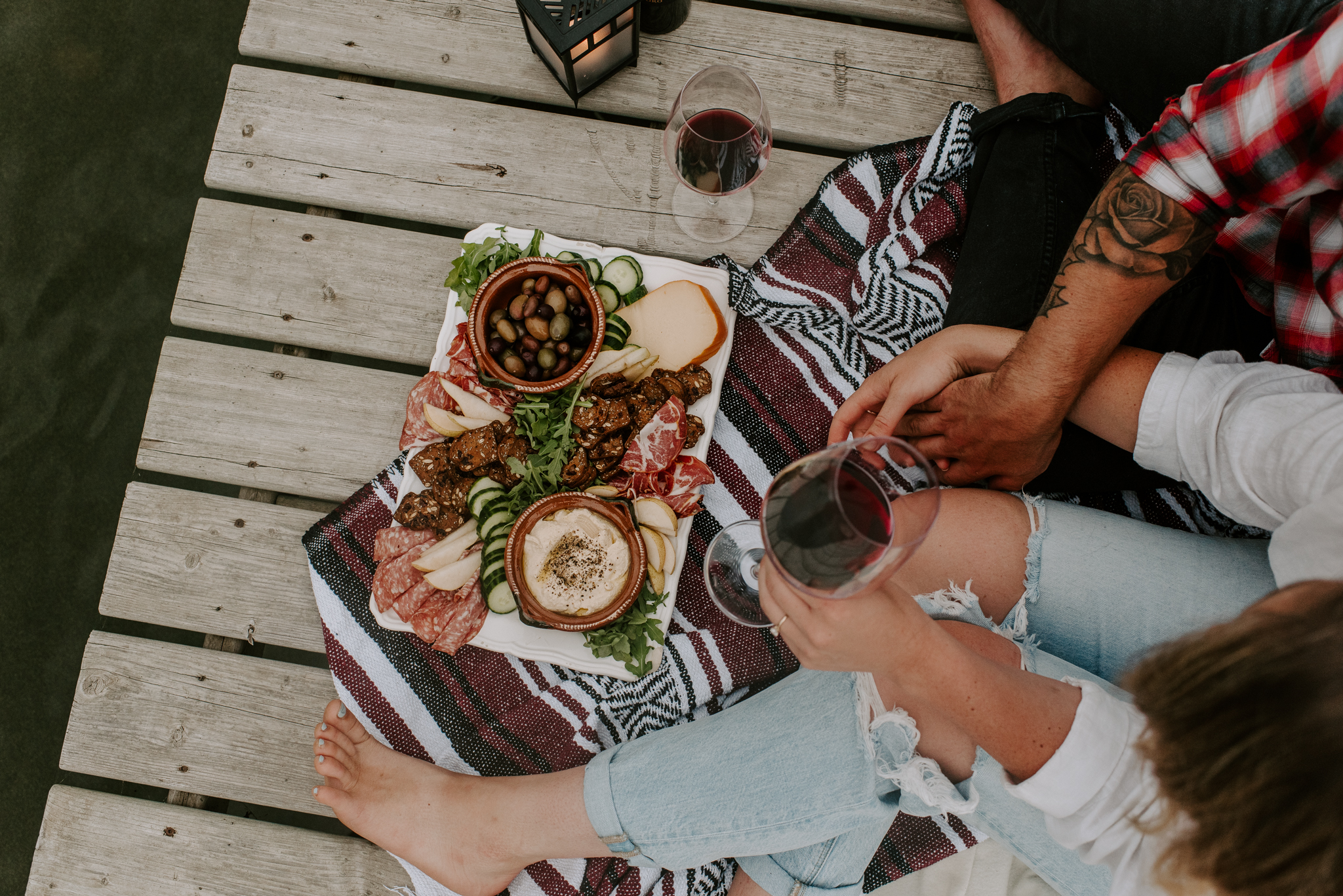 Lakeside engagement session with charcuterie board