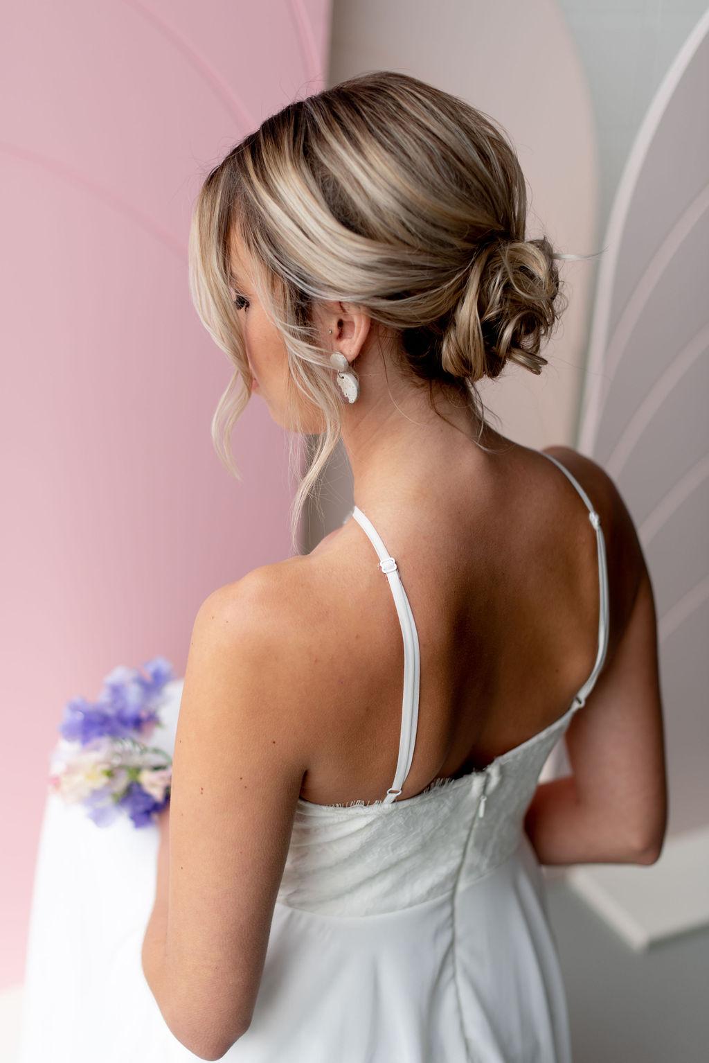 Bridal portrait, sweet peas, romantic updo