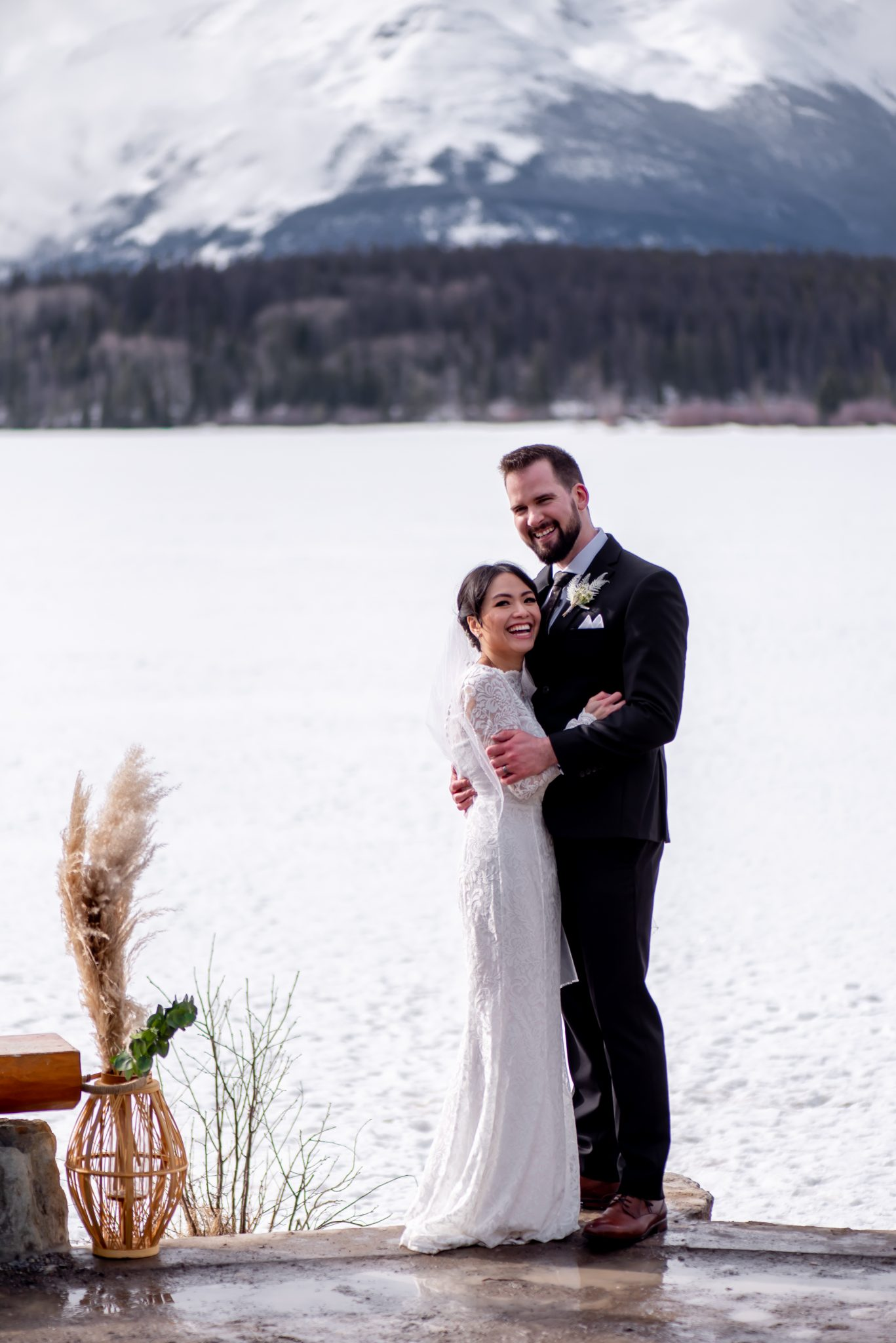 Bride and groom embrace at Pyramid Lake Island after their elopement ceremony in Jasper National Park