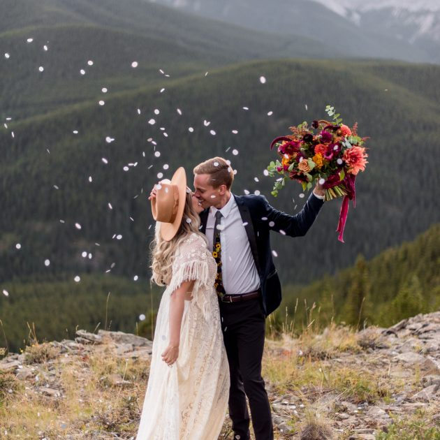 Boho bride and groom celebrate their wedding on a mountain plateau in southern Alberta
