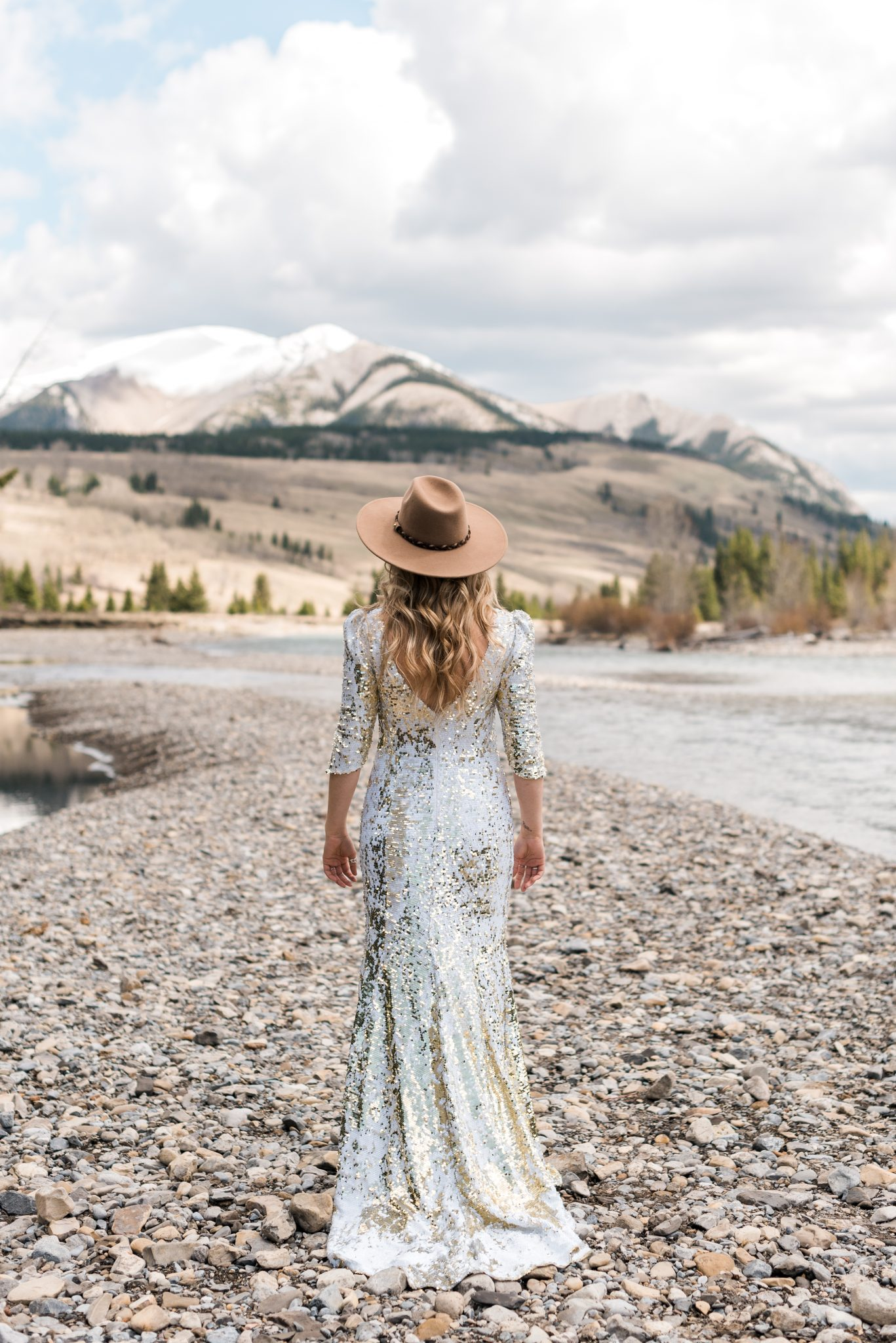 Canadian Cowgirl Bridal Inspiration in the Canadian Rockies with a white and gold sequin gown
