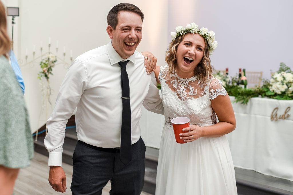 Candid photograph of a bride enjoying her wedding reception at Studio 96 in Edmonton Alberta
