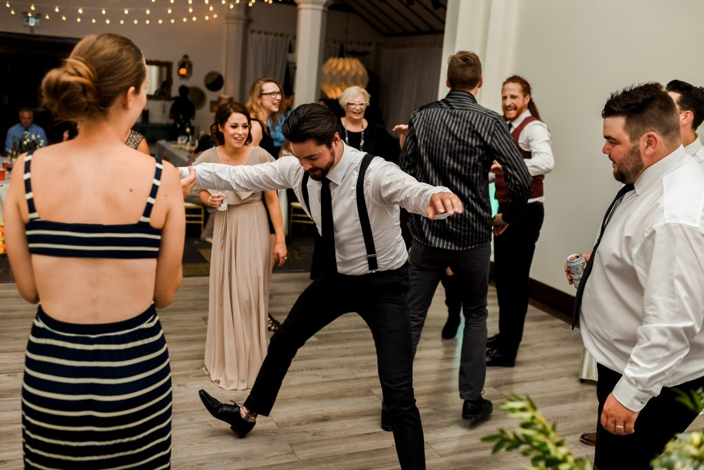 A groomsmen shows off his dance moves at Studio 96 in Edmonton Alberta