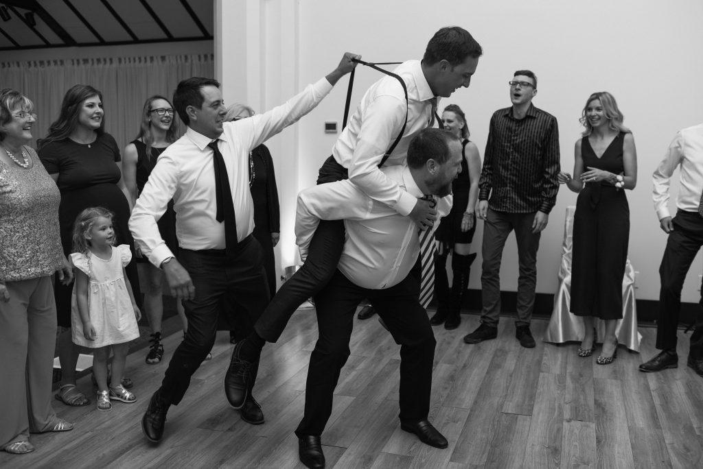 Groomsmen dance on the dance floor at Studio 96