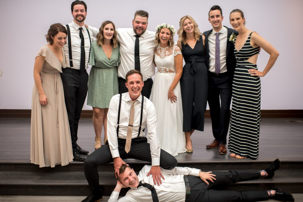 Wedding party and friends pose for a group photo at Studio 96 in Edmonton Alberta