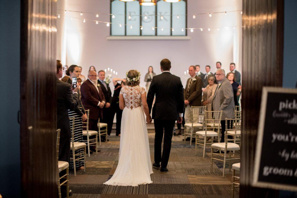 Bride and groom walk into Studio 96 for their September wedding ceremony in Edmonton Alberta