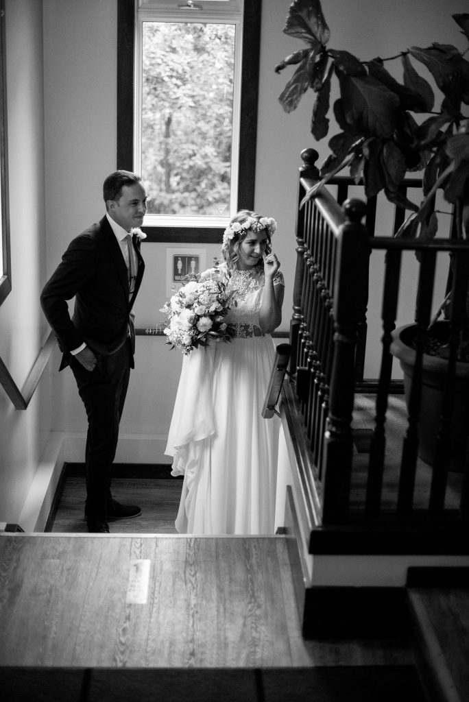 Bride and groom share an intimate moment alone before their wedding ceremony