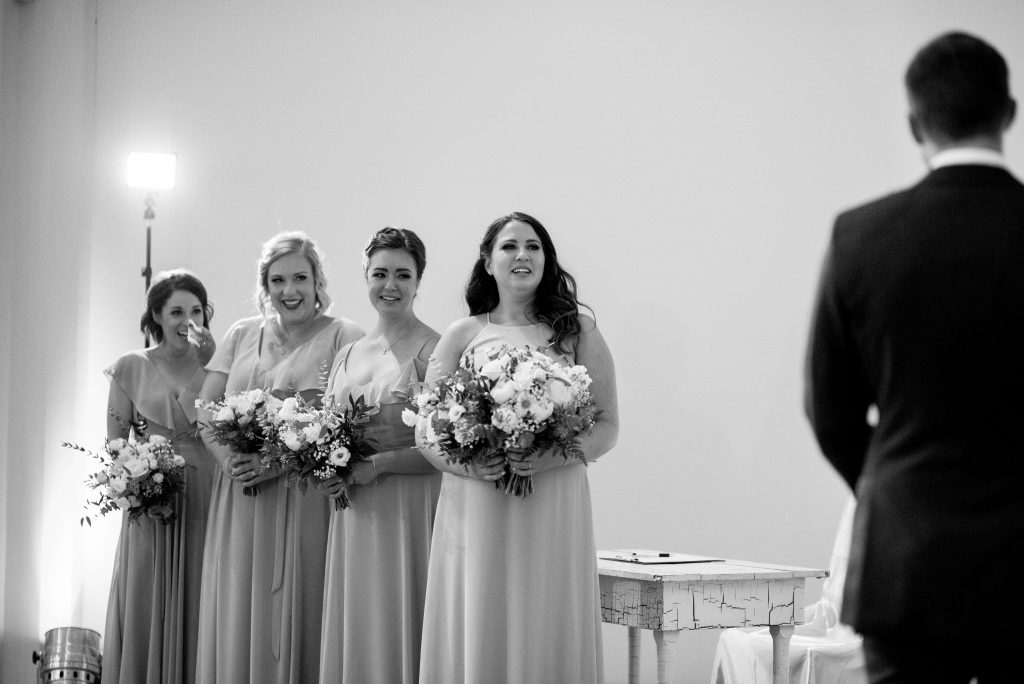 Bridesmaids react to the wedding ceremony at Studio 96 in Edmonton Alberta