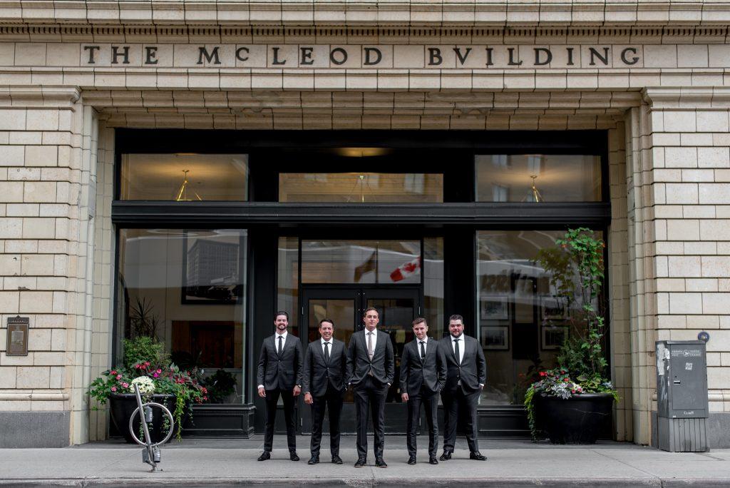 Groomsmen portrait taken in downtown Edmonton Alberta in front of the McLeod Building