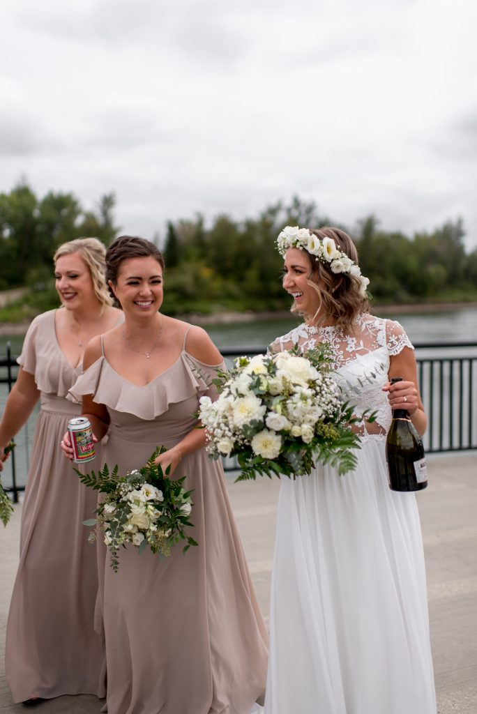 Bride enjoys a bottle of champagne