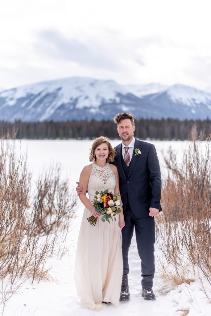 Jasper National Park elopement inspiration from the snowy winter shoreline of Lake Annette for this winter mountain elopement