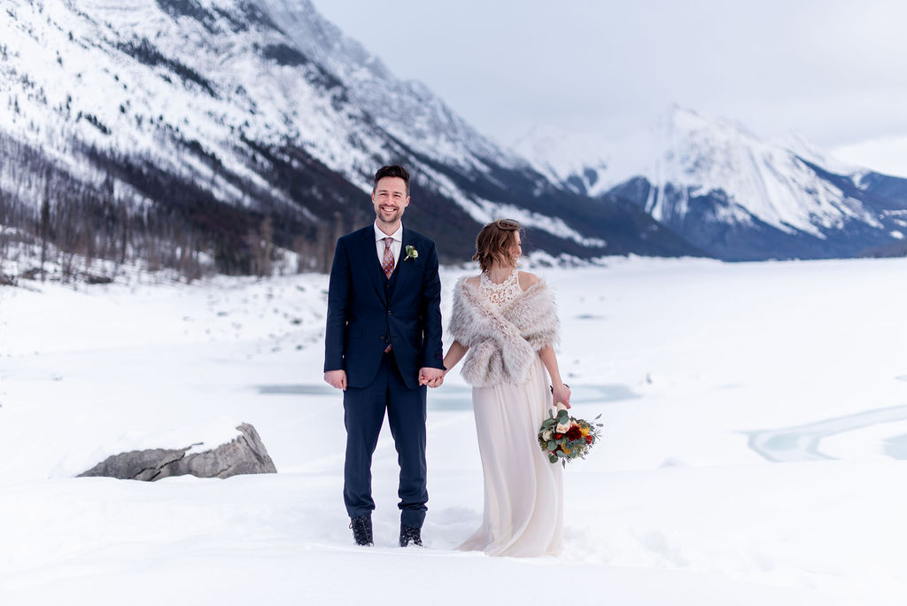 Winter mountain elopement inspiration at Medicine Lake in Jasper National Park