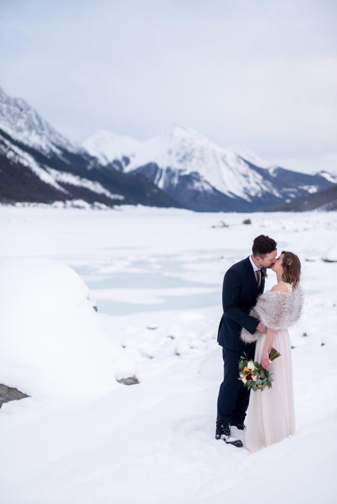 Romantic winter elopement inspiration at Medicine Lake in Jasper National Park
