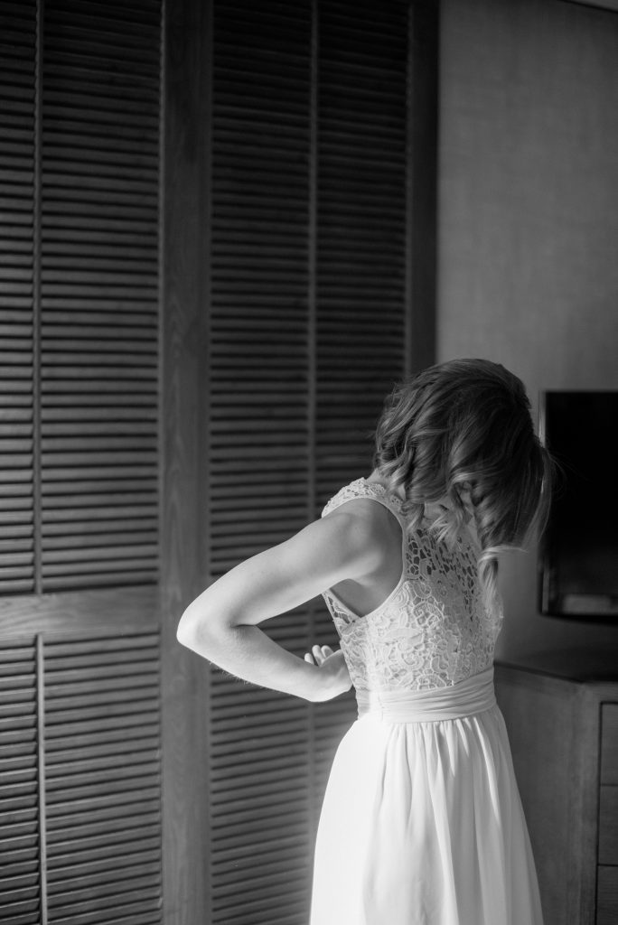 Bride slips into her wedding gown on the morning of her Jasper National Park elopement