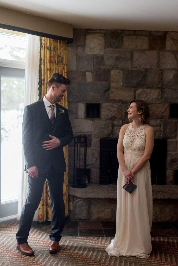 Eloping bride and groom's first look at the Fairmont Jasper Park Lodge the morning of their winter elopement