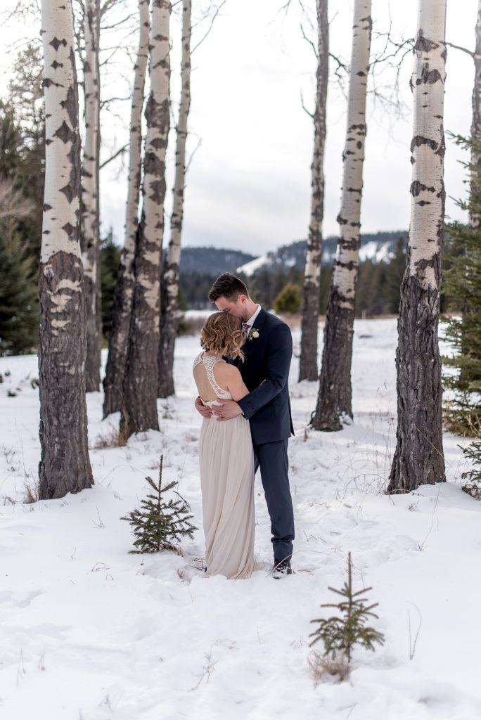Jasper National Park elopement inspiration in amongst the Aspen trees at Lake Annette for this winter elopement