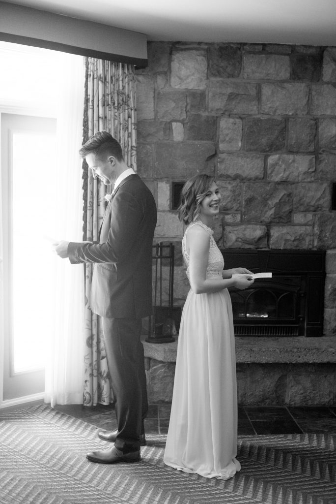 Bride and groom exchange hand written letters with one another on the morning of their wedding day at the Fairmont Jasper Park Lodge