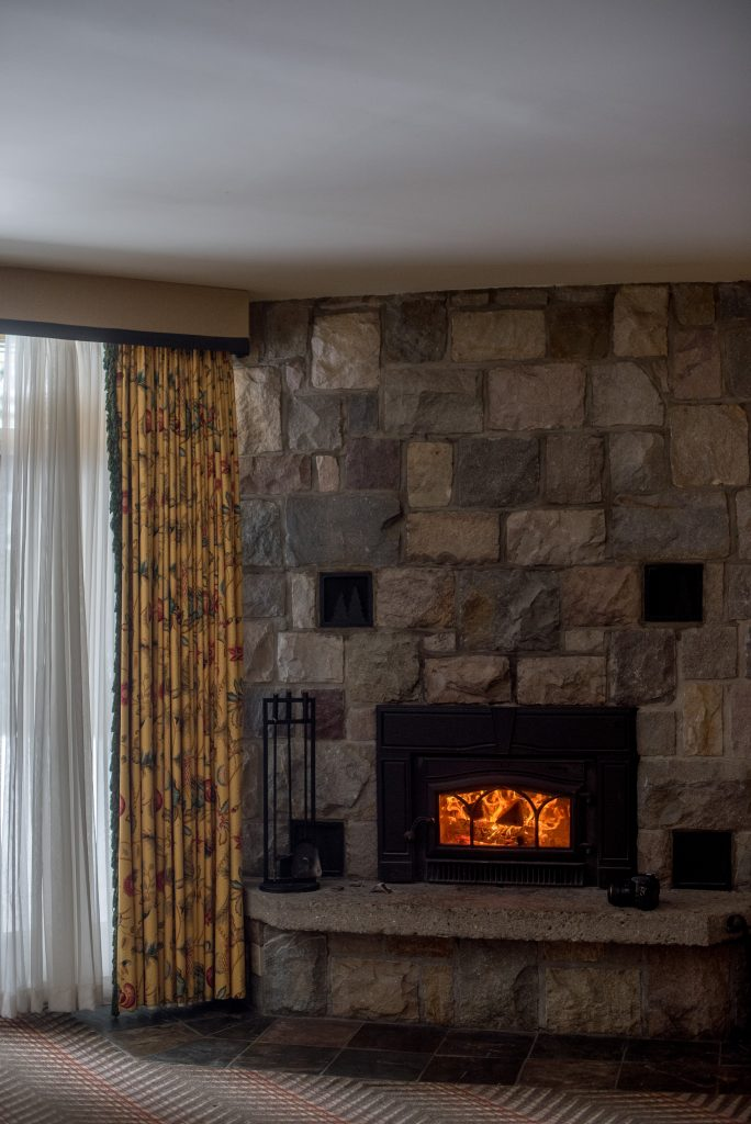 Fireplace is lit at a room at the Fairmont Jasper Park Lodge