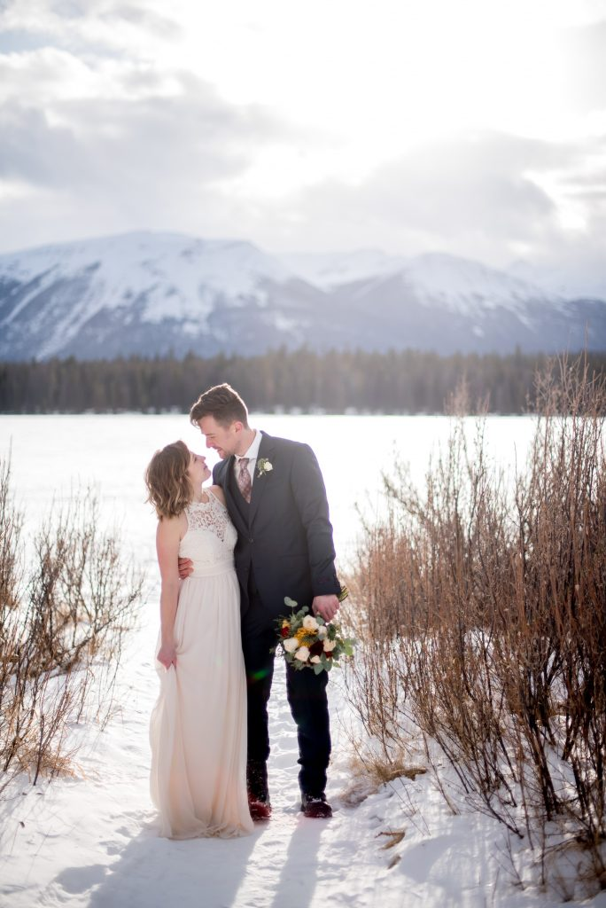 Jasper National Park elopement inspiration on a winter day in February for this mountain elopement