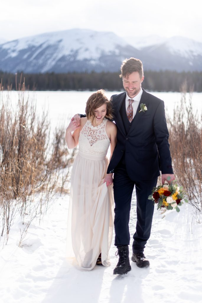 Jasper National Park elopement inspiration from the snowy shoreline of Lake Annette for this winter mountain elopement