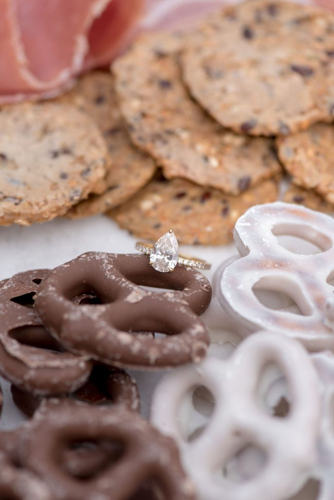 Pear shaped engagement session with chocolate pretzles
