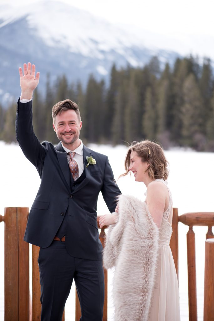 Eloping bride and groom celebrate after their intimate winter elopement in Jasper National Park