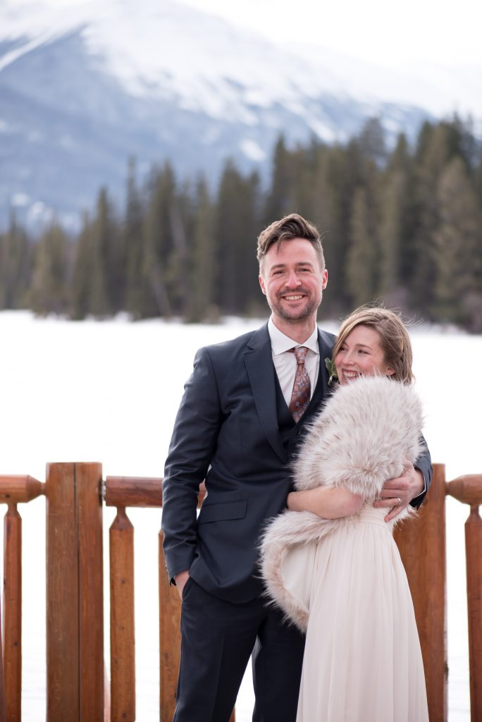 Bride and groom celebrate after their intimate elopement at Jasper National Park