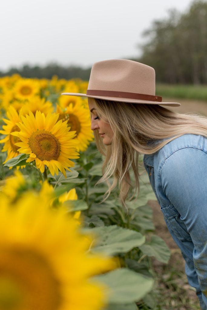 Girl smells sunflowers